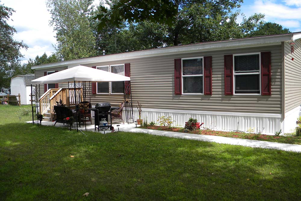 Manufactured Home with patio covered with pop up tent