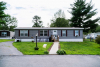 Manufactured Home with chairs out front